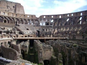 An interior photograph of the Colosseum showing the subterranean level below the Arena