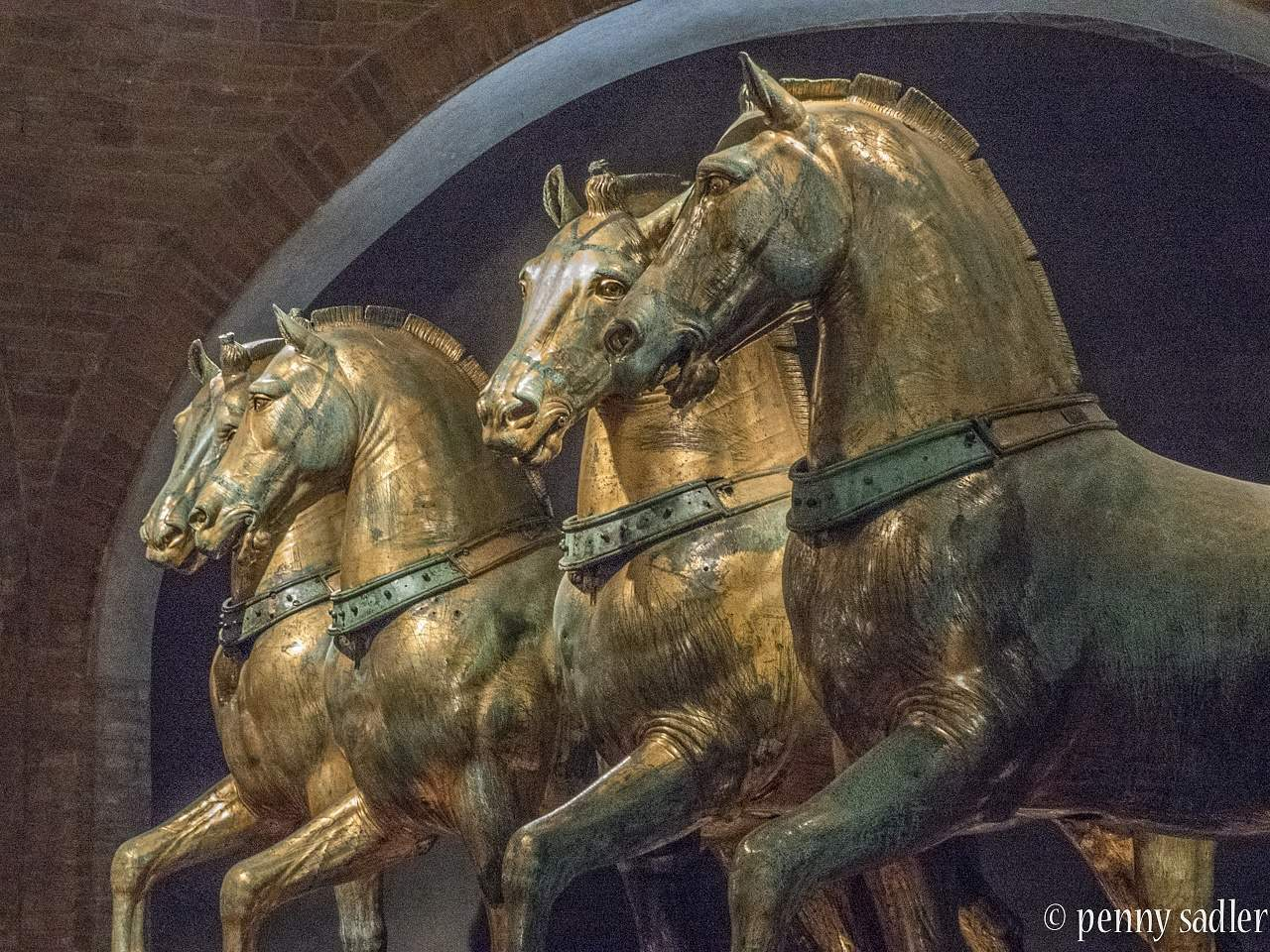 A side view of the four bronze horses of St Marks Basilica.